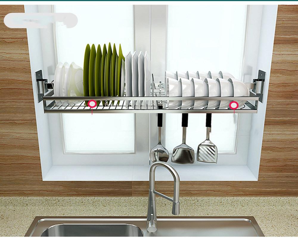 rak dapur stainless steel pada jendela dapur