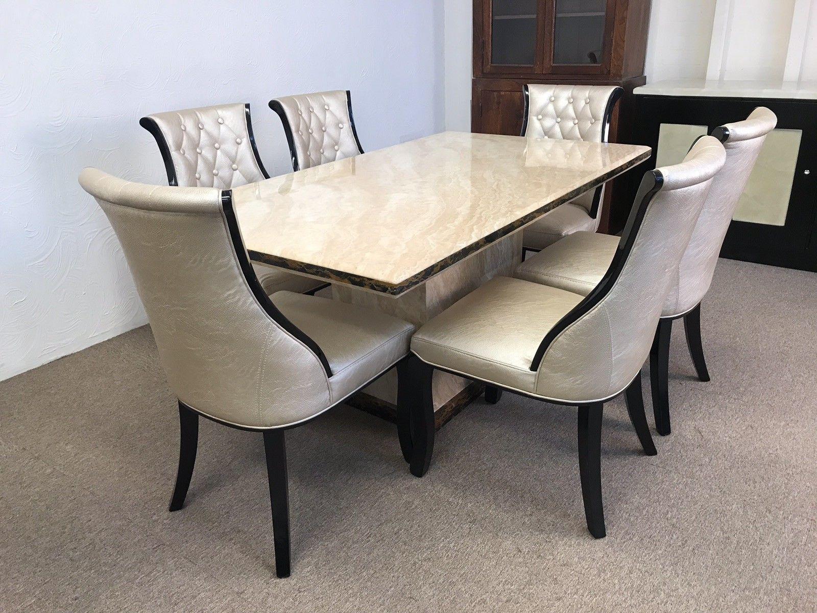 meja makan mewah dengan 6 kursi silver yang glamor